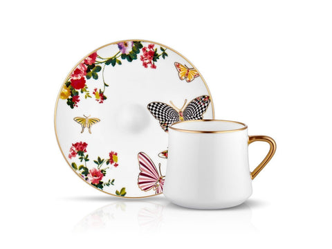White coffee cups with butterfly and flower patterns