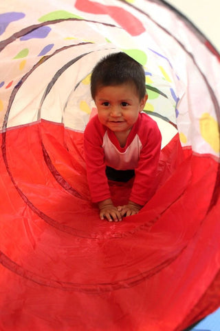 Baby Boy Playing in Polka Dot Play Tunnel