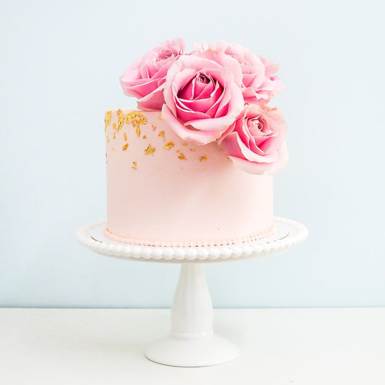 Garden Rose buttercream cake with fresh roses and 24 carat gold leaf