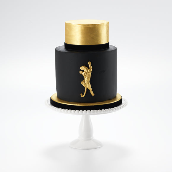 A sophisticated mans cake.The legendary panther is immortalised in gilded sugar on this luxurious gold and black iced cake. The Panther is by all accounts a  bold cake, sure to leave an impression on any occasion.