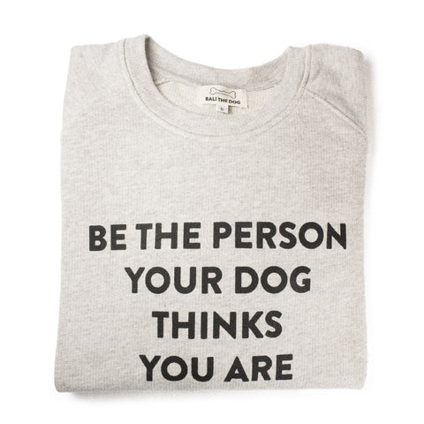 Bali the Dog Classic female sweatshirt for her in cool grey melange. Made from soft cotton, black print on grey on the chest, 'Be the person your dog thinks you are'. Coolest dog clothes and dog gear from Bali the Dog, for all dog owners!