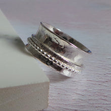 Silver spinner ring with hammered texture