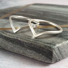 Silver wishbone bands