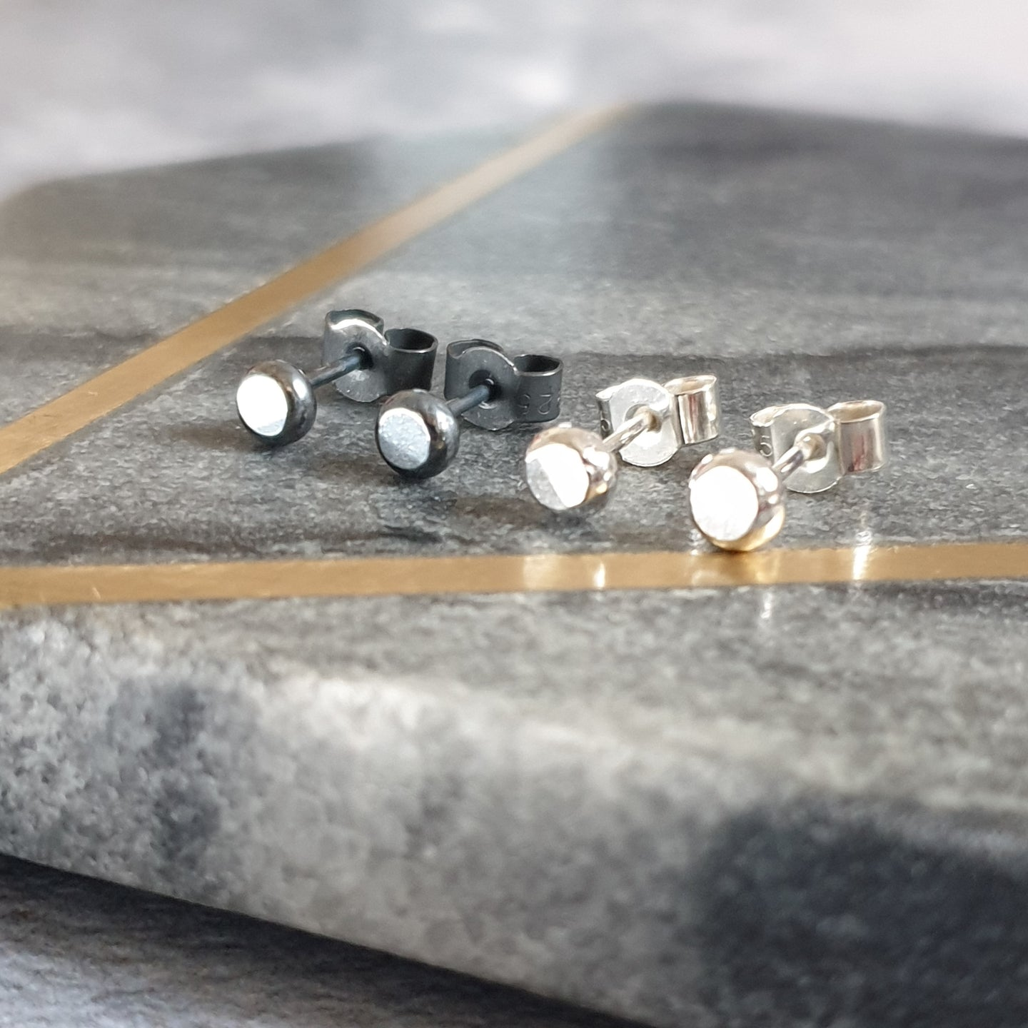 Black or silver stud earrings