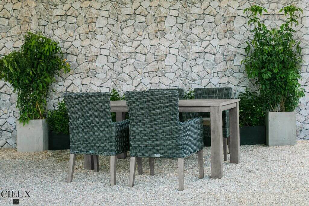Patio table with four grey chairs