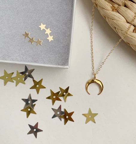 Earrings of the week in Star Crawler earrings and Moon necklace