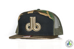 db Hat – 7 Panel Green Camo