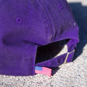 dirt shop hat made in the usa purple with green embroidery