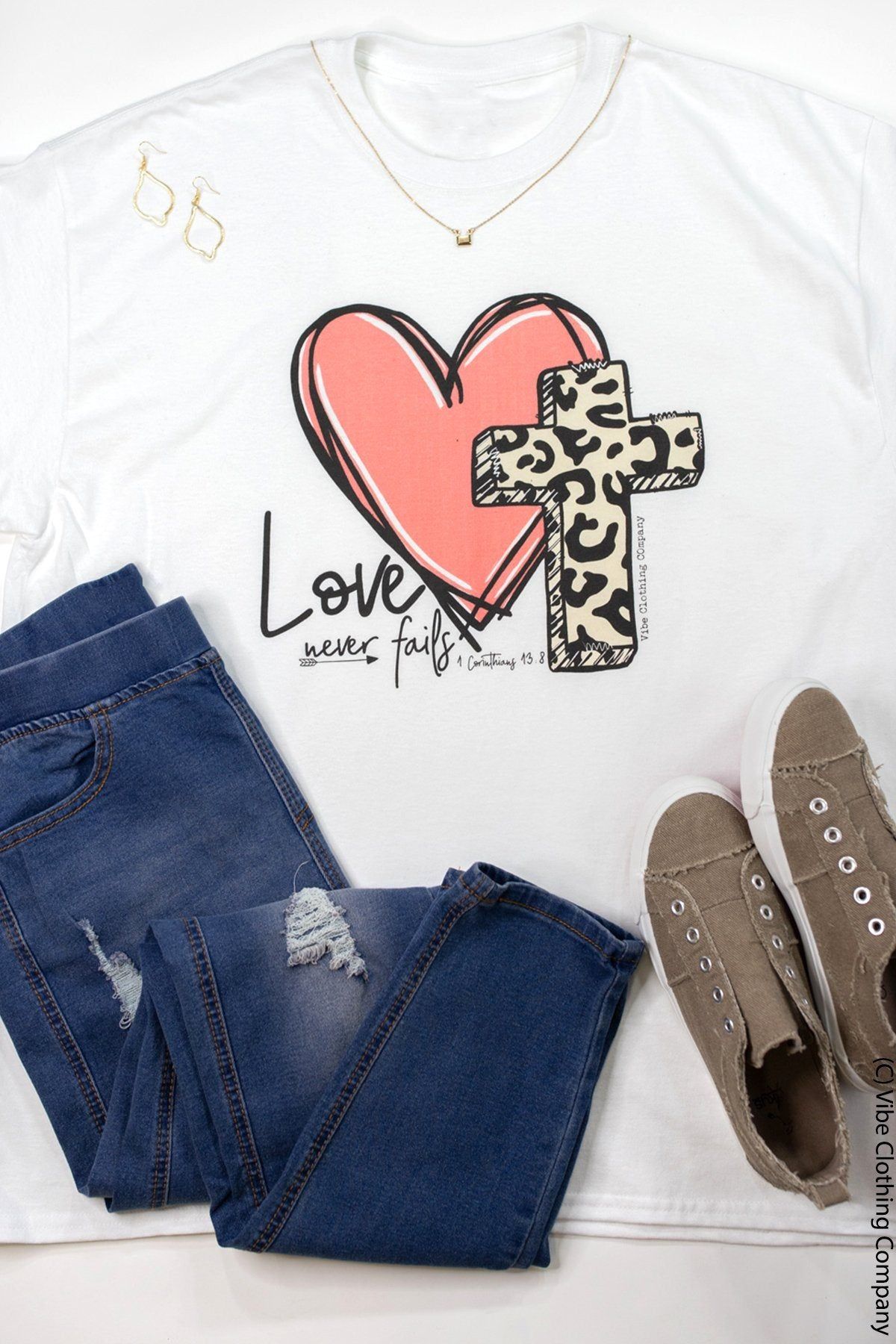 Love Never Fails Graphic Tee graphic tees Mark tee Small White