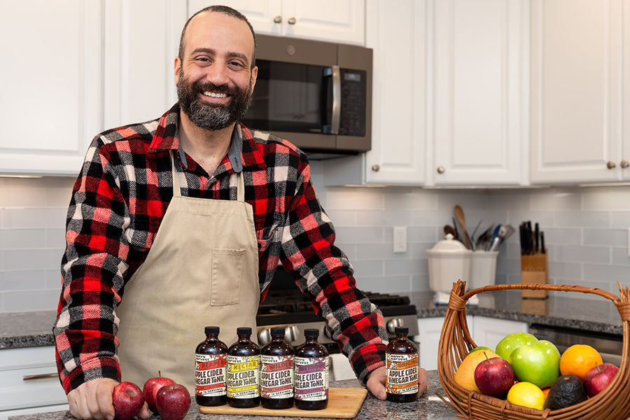 Hany's the Founder of Hany's Harvest at home with his fire cider tonics.