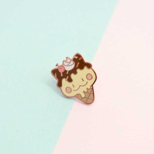 milky parlor fudge cat enamel pin