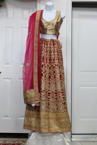 Heavy golden-red-pink combination of Bridal lehenga