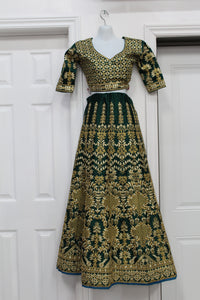 Heavy golden work green lehenga