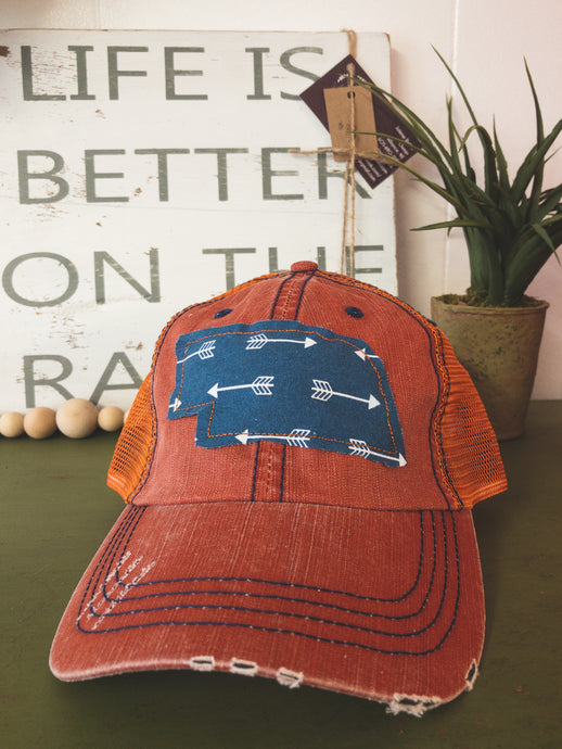 Navy arrow patch - orange/navy trucker hat