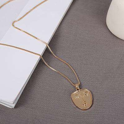 Vintage Metal Face Pendant Necklace