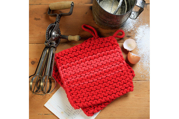 a pair of retrokitchen knitted trivets in red