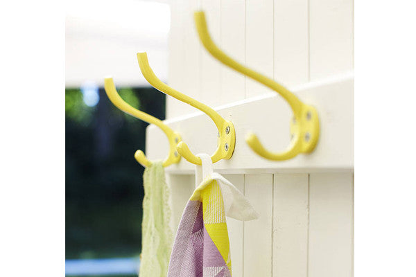 retrokitchen yellow wall hooks on timber door