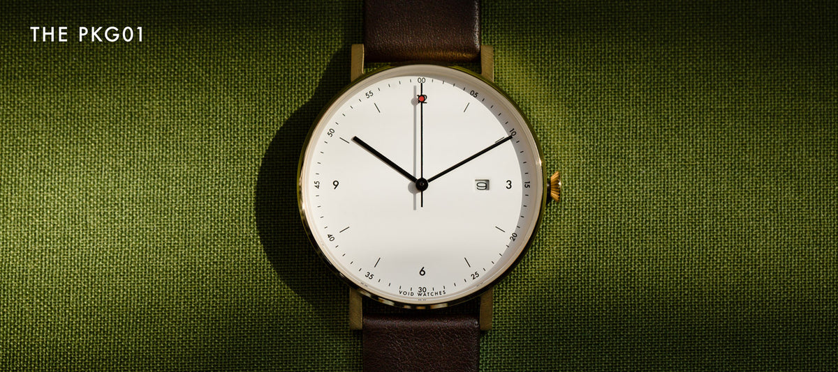 The classic PKG01-GO/DB/WH by VOID Watches. Gold watch with dark brown strap.