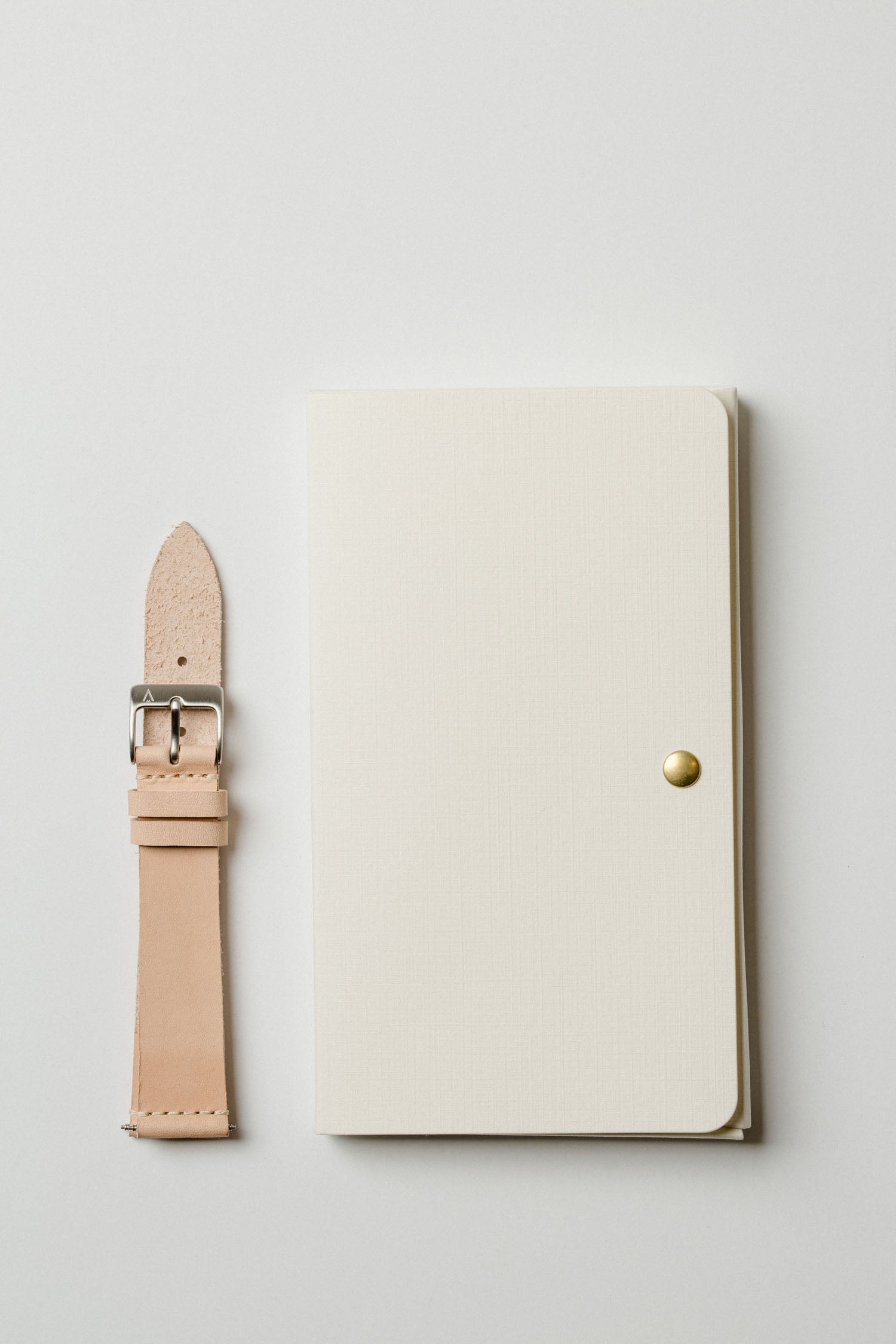 VOID Watches's off-white strap packaging featuring a Swedish vegetable tanned leather strap.