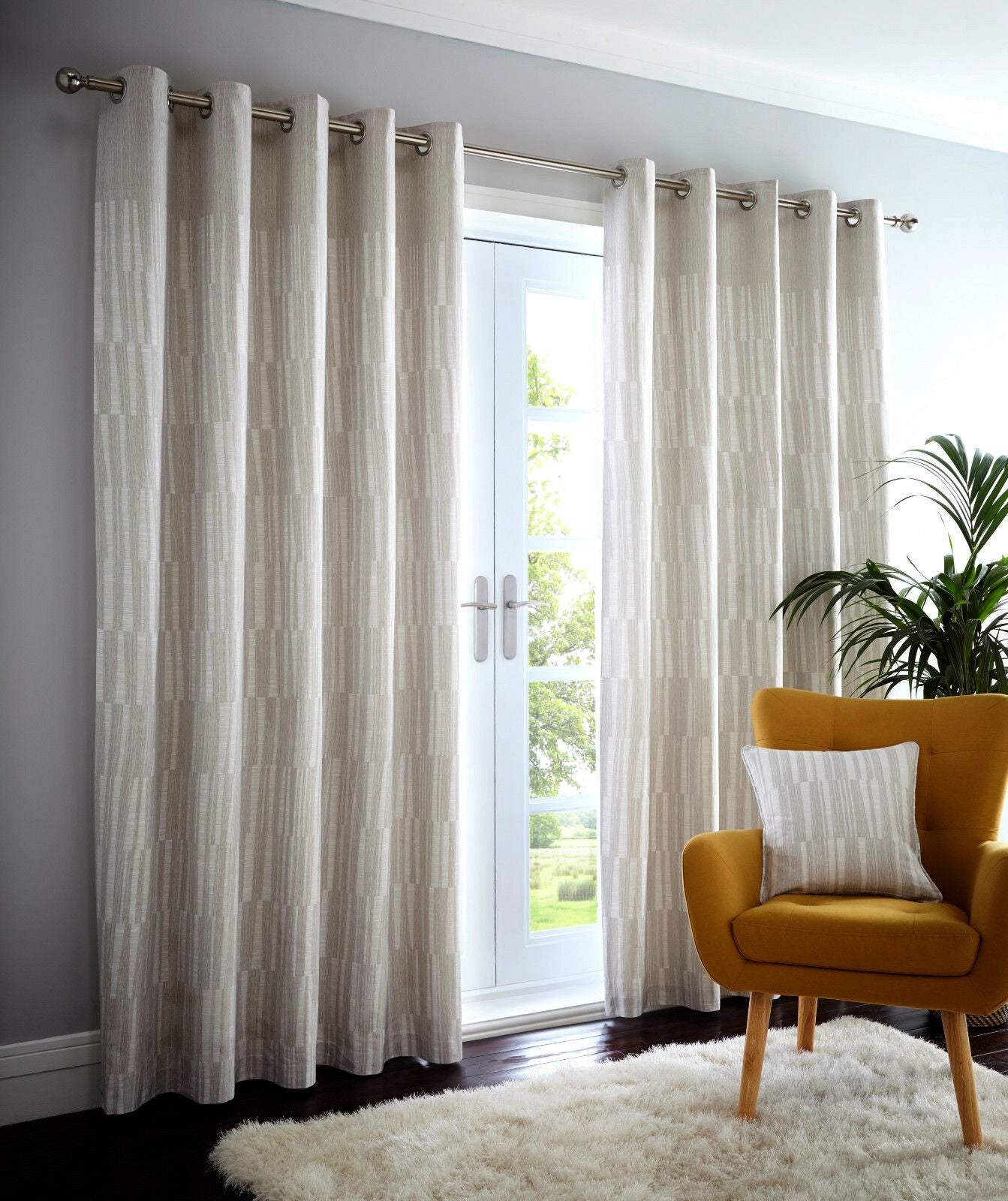 Detriot Lined curtains with eyelet ring tops in beige ivory