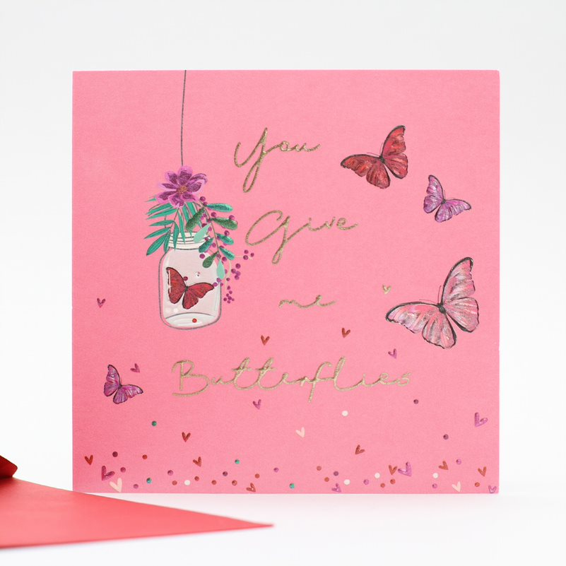 pink background with butterflies and jam jar with gold embossed writing you give me butterflies valentines small card