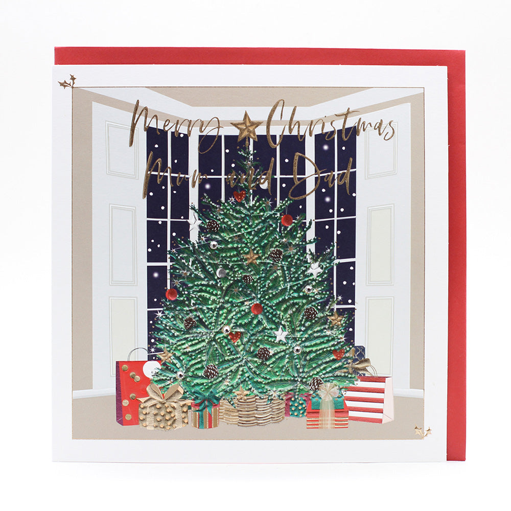 Bright large Christmas tree with presents underneath embossed with gold foil