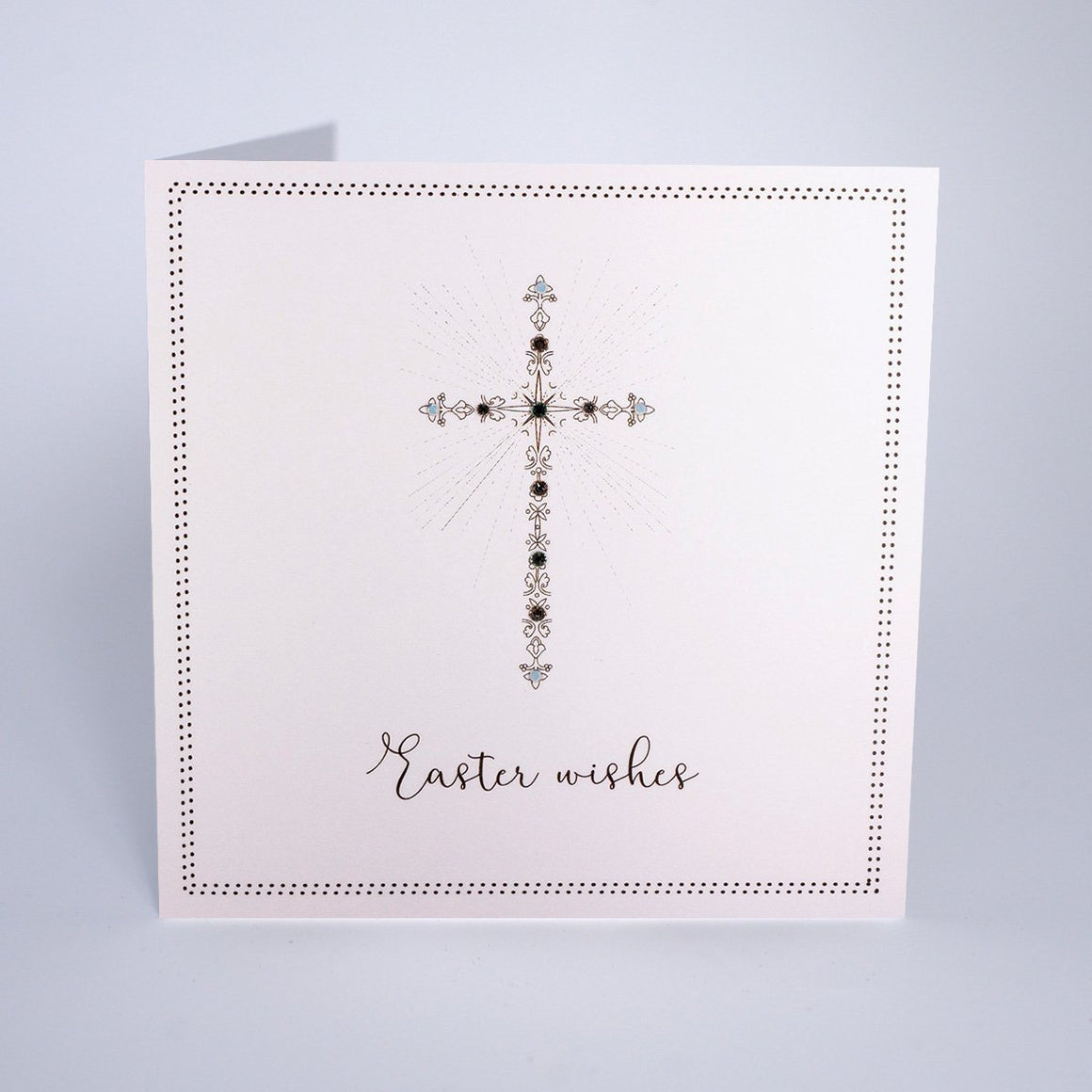 Beautiful jewelled cross on a white background