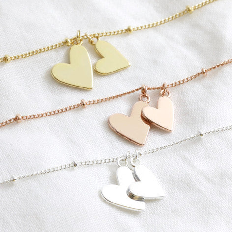 silver, rose gold and gold double hearts on satellite bracelet