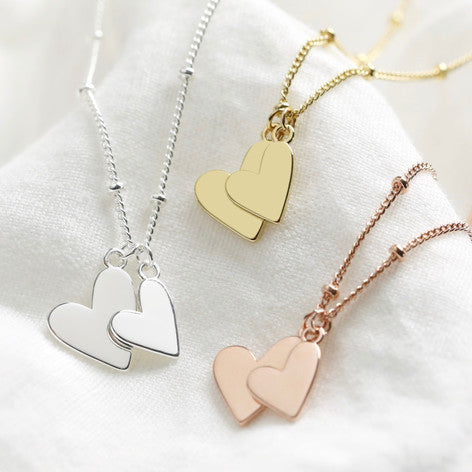 Three different plated double heart necklaces