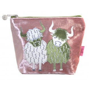 Pink velvet cosmetic bag with a cream and lime highland cow applique.