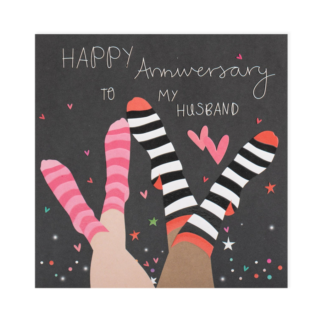 happy anniversary to my husband black background to pairs of feet with striped socks on and hearts