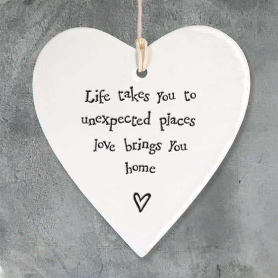 Life takes you to unexpected places love brings you home porcelain hanging heart