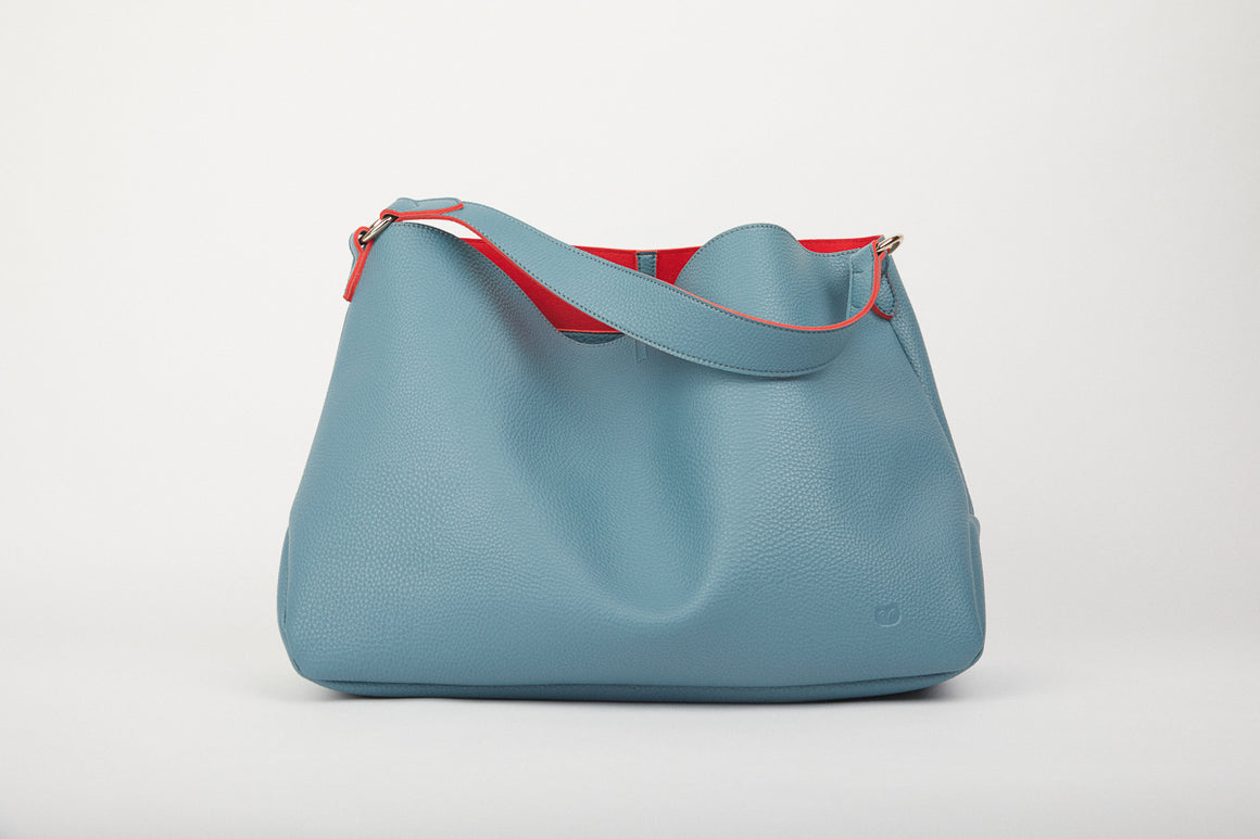 vegan friendly teal slouch bag with red trim clasp with internal zip pocket