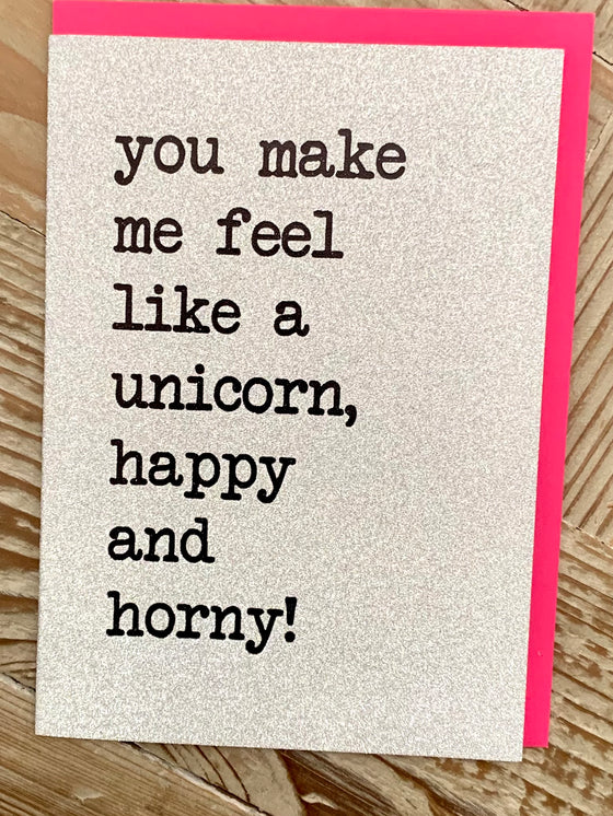 Silver glitter card with black typeface 'you make me feel like a unicorn, happy and horny!
