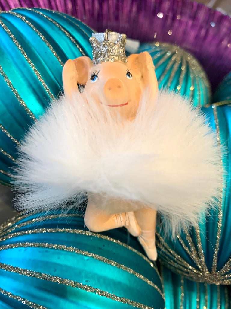 resin ballerina pig with arms up in a white tutu