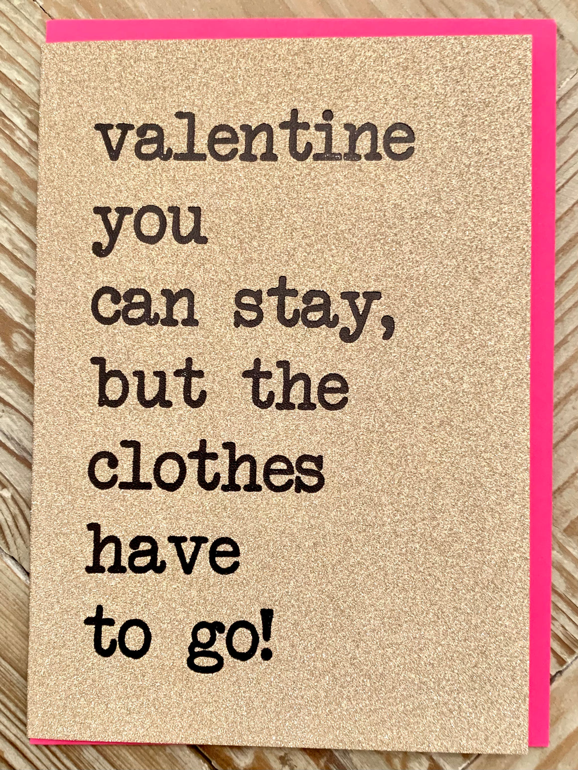 gold glitter card with black typeface valentine you can stay, but the clothes have to go!