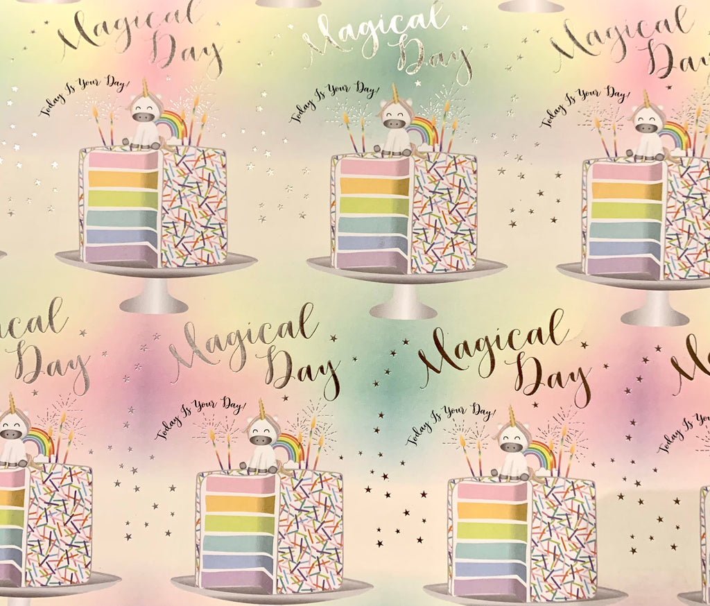 single sheet of wrapping paper with unicorns sitting on large slices of rainbow coloured cake with the words Magical Day