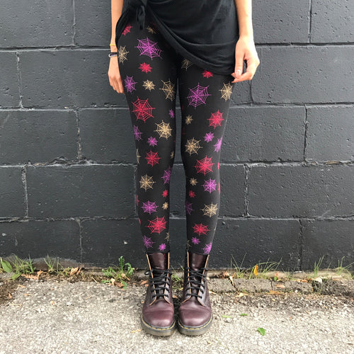 Super soft, ultra stretchy, very comfortable, high waisted, non-pilling leggings in a super fun Halloween print that fits kids 3T, adults one size, and plus sizes 2X, 3X, 4X, 5X - this design has a black background with red, purple, and golden yellow spider webs! Spook things up this Halloween with this pattern! Feels like second skin, buttery soft, super smooth, bright vibrant prints!