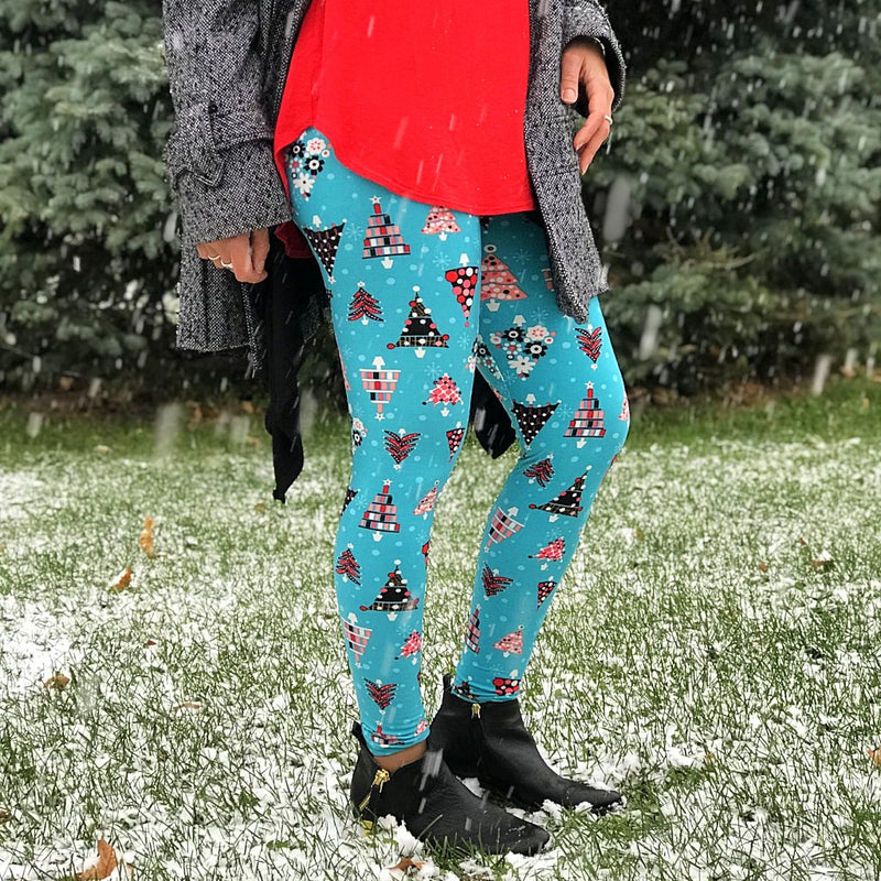 Ultra soft, super comfy leggings made with a unique, 4-way stretch, non-pilling fabric of great quality. Patterns and colours are vibrant and opaque and are not distorted when stretched and worn. This pattern is a gorgeous bright blue base with unique Christmas tree designs in pink, red, white, and black.