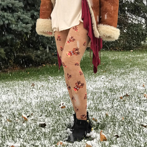 Ultra soft, super comfy leggings made with a unique, 4-way stretch, non-pilling fabric of great quality. Patterns and colours are vibrant and opaque and are not distorted when stretched and worn. This pattern is a cute brown based, winter print with the legendary Rudolph the red nosed reindeer and a subtle snowflake design in the background.
