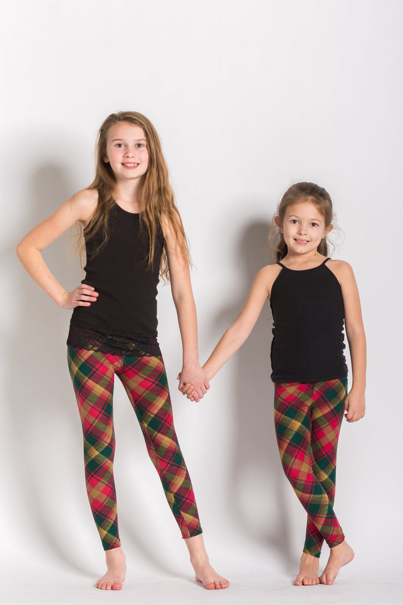 front view kids size Canadian maple leaf tartan leggings - colours of this plaid are gold, dark green, and red and can be worn casually or dressy! Plaid design is angled for a more visually pleasing look - also helps with pattern symmetry and matching at seams.