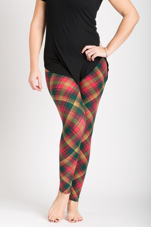 front view adults one size Canadian maple leaf tartan leggings - colours of this plaid are gold, dark green, and red and can be worn casually or dressy! Plaid design is angled for a more visually pleasing look - also helps with pattern symmetry and matching at seams.