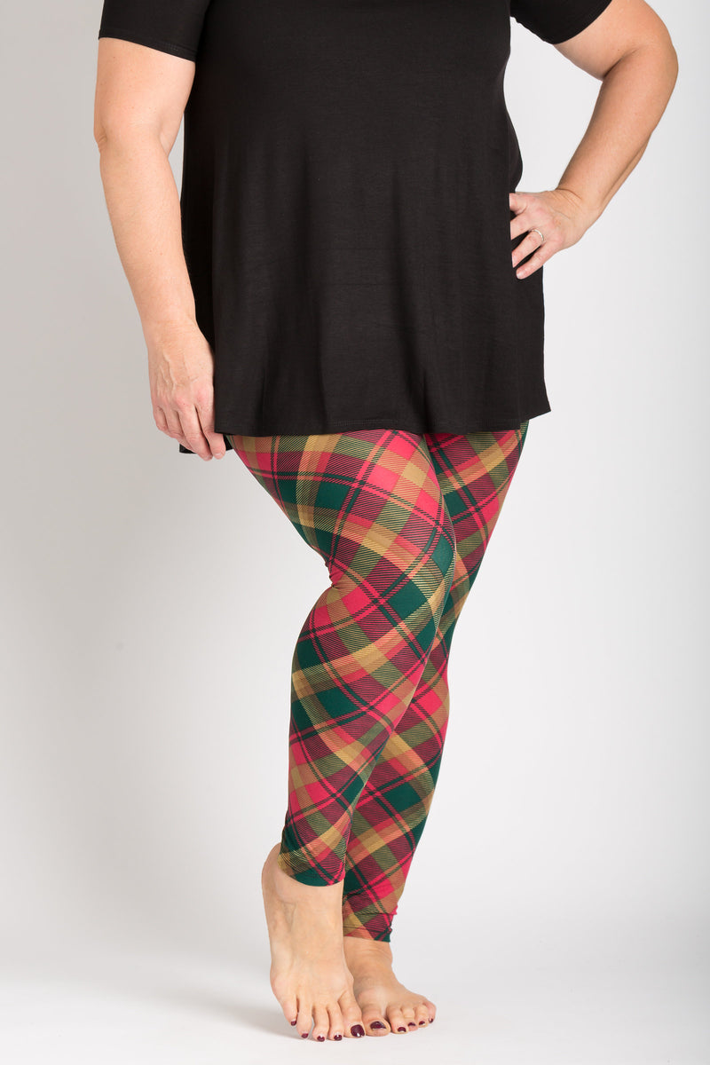 front view adults plus size 2X-5X Canadian maple leaf tartan leggings - colours of this plaid are gold, dark green, and red and can be worn casually or dressy! Plaid design is angled for a more visually pleasing look - also helps with pattern symmetry and matching at seams.
