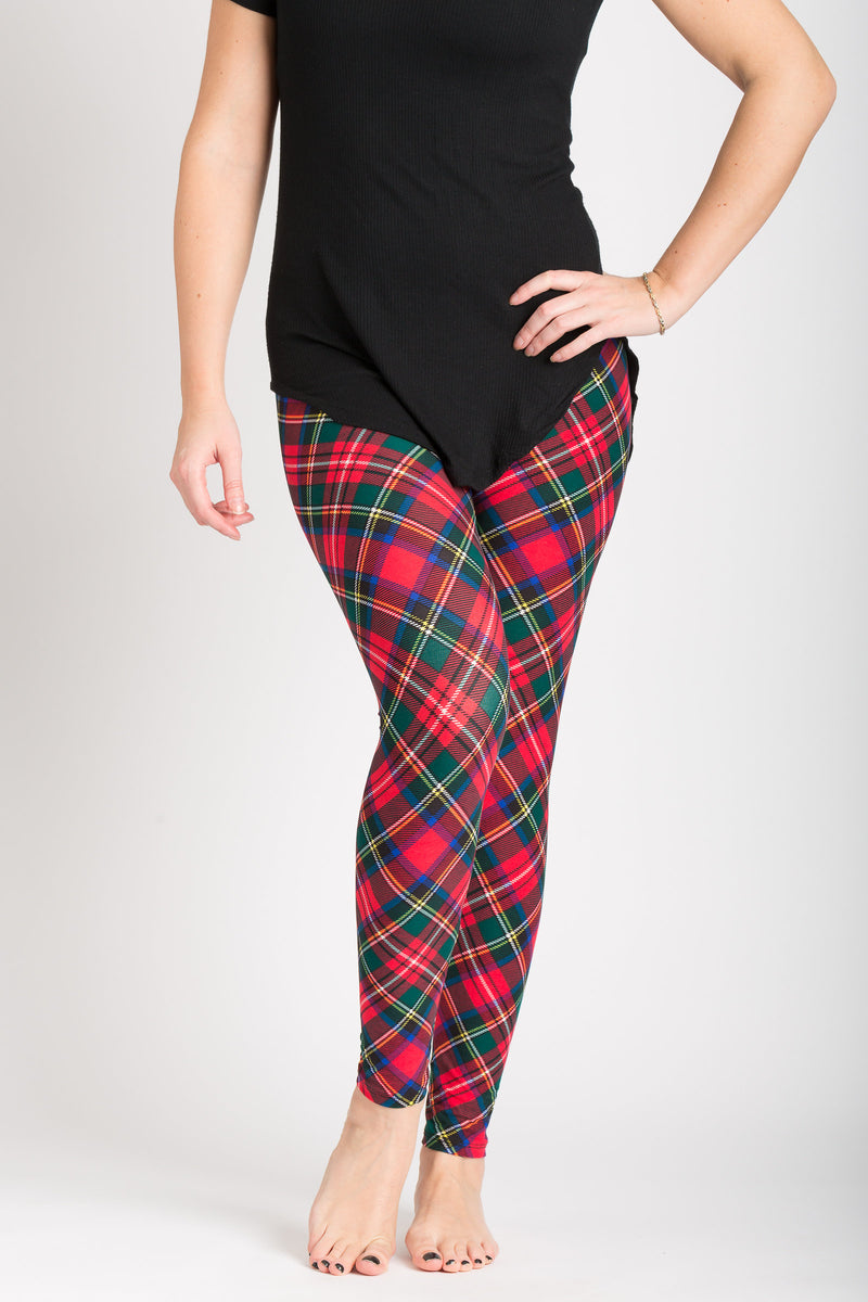 front view adults one size Royal Stuart tartan leggings - colours of this plaid are primarily red, with hints of blue, green, white, and black and can be worn casually or dressy! Plaid design is angled for a more visually pleasing look - also helps with pattern symmetry and matching at seams.