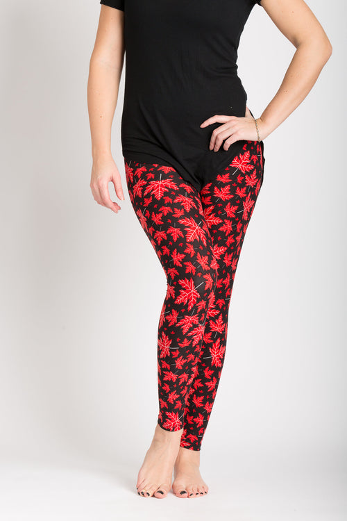 front view adults one size Canada theme leggings - black base with red maple leaves - leaves have subtle vein designs in white colour. Perfect for Canada day and travelling! Ultra Canadian!