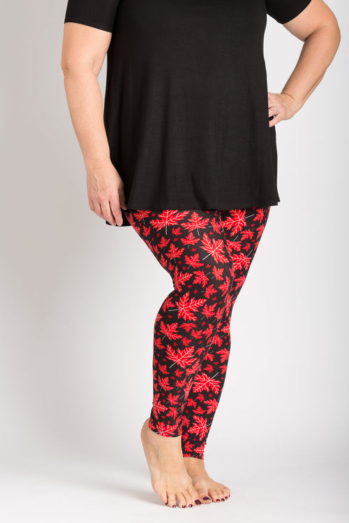 front view adults large one size Canada theme leggings - black base with red maple leaves - leaves have subtle vein designs in white colour. Perfect for Canada day and travelling! Ultra Canadian!