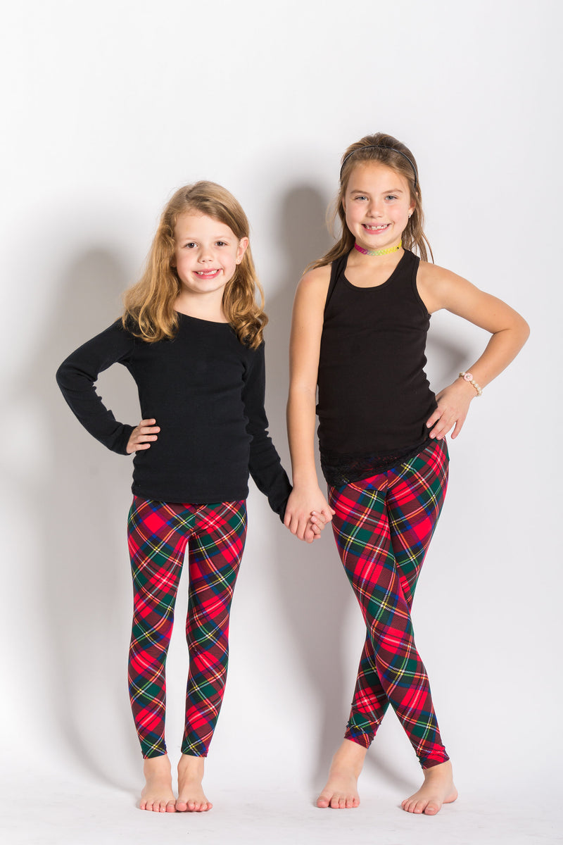 front view kids size Royal Stewart tartan leggings - colours of this plaid are primarily red, with hints of blue, green, white, and black and can be worn casually or dressy! Plaid design is angled for a more visually pleasing look - also helps with pattern symmetry and matching at seams.