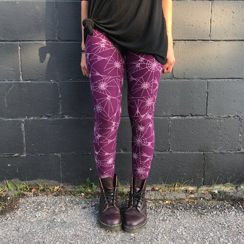 Super soft, ultra stretchy, very comfortable, high waisted, non-pilling leggings in a super fun Halloween print that fits kids 3T, adults one size, and plus sizes 2X, 3X, 4X, 5X - this design has a deep purple background with white spider webs stretched all over! Spook things up this Halloween with this pattern! Feels like second skin, buttery soft, super smooth, bright vibrant prints!