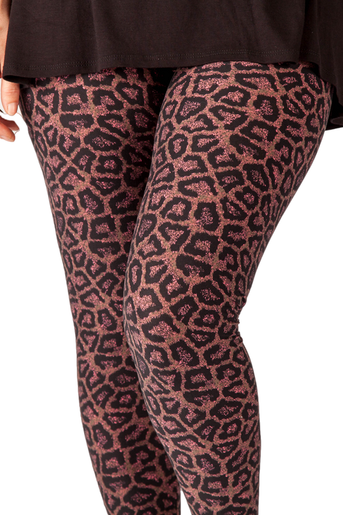 Ultra soft, super comfy leggings made with a unique, 4-way stretch, non-pilling fabric of great quality. Patterns and colours are vibrant and opaque and are not distorted when stretched and worn. This pattern is a fun spin on the conventional animal print with purple and pink colours.