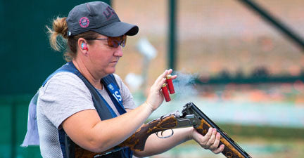 Kim Rhode ejecting 2 shells from a beretta shotgun at the Olympic games in Rio